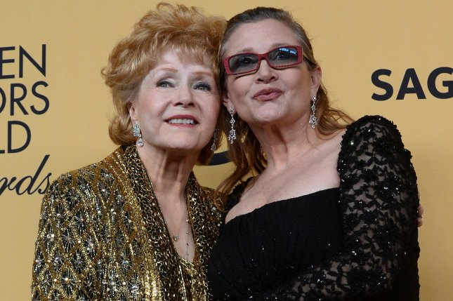 Mother-daughter actresses Debbie Reynolds, left, and Carrie Fisher were honored by hundreds of fans at a memorial service in Los Angeles on Saturday. The women died a day apart from one another in December. File Photo by Jim Ruymen/UPI