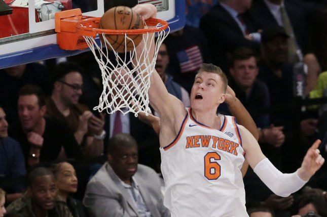 New York Knicks' Kristaps Porzingis dunks the basketball in the first half against the Utah Jazz on Wednesday at Madison Square Garden in New York City. Photo by John Angelillo/UPI