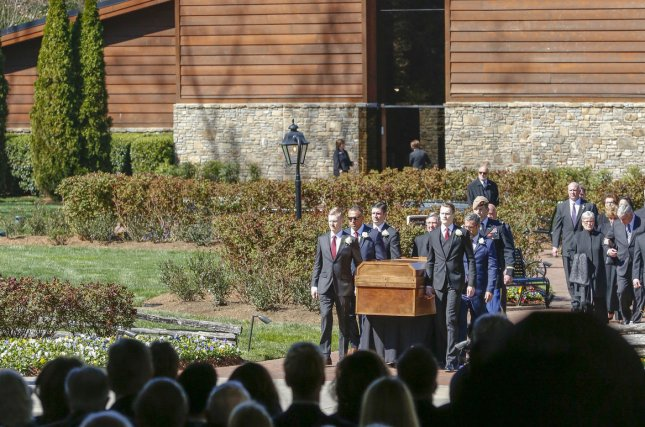 The casket of evangelist Rev. Billy Graham is carried by his grandsons Friday at the Billy Graham Library in Charlotte, N.C. Graham died February 21 at the age of 99. Photo by Nell Redmond/UPI