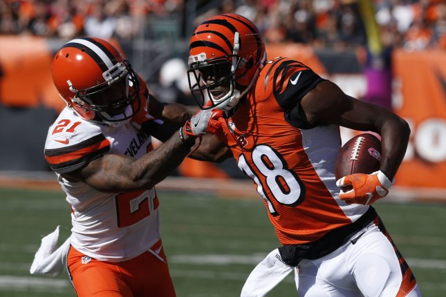Cincinnati Bengals wide receiver A.J. Green (18) fights to break free from Cleveland Browns cornerback Jamar Taylor (21) during the first half of play on October 23, 2016 at Paul Brown Stadium in Cincinnati, Ohio. File photo by John Sommers II/UPI