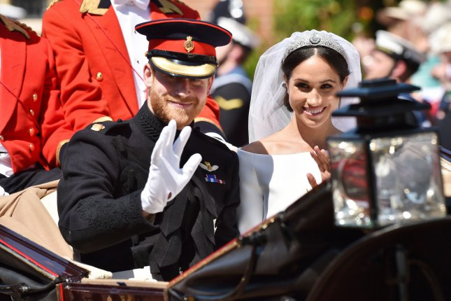 Prince Harry (L) and Meghan Markle attended a fête for Prince Charles on Tuesday. File Photo by Lionel Hahn/UPI