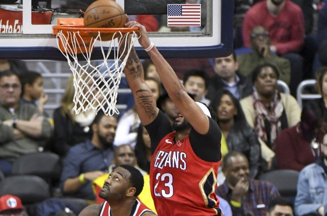 New Orleans Pelicans forward Anthony Davis (23) dunks the ball on a rebound against Washington Wizards guard John Wall (2) in the first half on December 19 at Capital One Arena in Washington, D.C. Photo by Mark Goldman/UPI