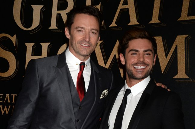 Zac Efron and Hugh Jackman arrive on the red carpet at the The Greatest Showman world premiere on December 8, 2017 in New York City. The movie musical won several prizes, including Best Movie Drama, at the Teen Choice Awards Sunday. File Photo by Dennis Van Tine/UPI