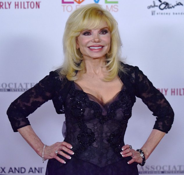 Loni Anderson arrives on the orange carpet for the 26th Annual Race to Erase MS Gala at the Beverly Hilton hotel in California on May 10, 2019. She turns 75 on August 5. File Photo by Chris Chew/UPI