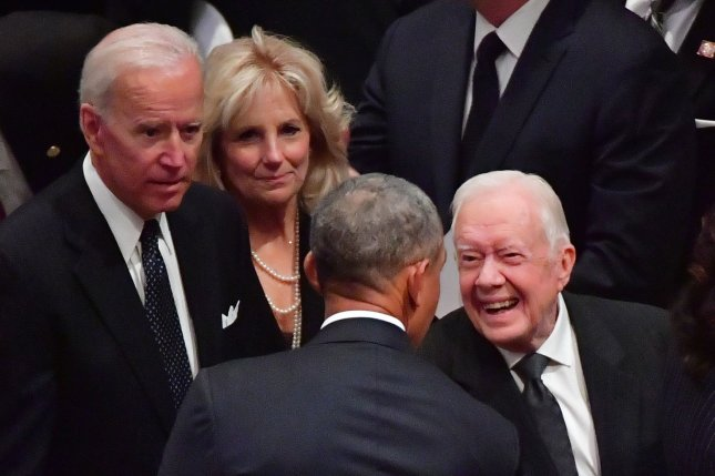 Former Presidents Jimmy Carter (R) and Barack Obama speak while former Vice President Joe Biden and his wife Jill look on at the funeral of President George H.W. Bush in Washington on December 5, 2018. File photo by Kevin Dietsch/UPI