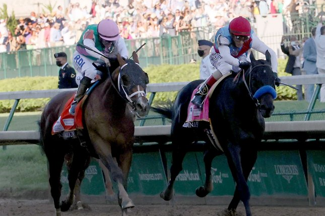 Medina Spirit (R), ridden by John Velazquez, beats Mandaloun with Florent Geroux up, to win the 147th running of the Kentucky Derby on Saturday at Churchill Downs in Louisville, Ky. Photo by Mark Abraham/UPI