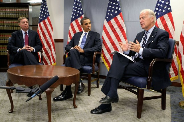 U.S. Vice President-elect Sen. Joseph Biden (D-DE) (R) speaks, as President-elect Barack Obama (C) and Sen. Lindsey Graham (R-SC) (L) listen, during a meeting regarding a recent trip to Southwest Asia at the transition office in Washington on January 14, 2009. Biden and Graham, who have recently returned from a trip to Afghanistan, Iraq, Kuwait and Pakistan, briefed Obama on their diplomatic findings. (UPI Photo/Alex Wong/POOL)