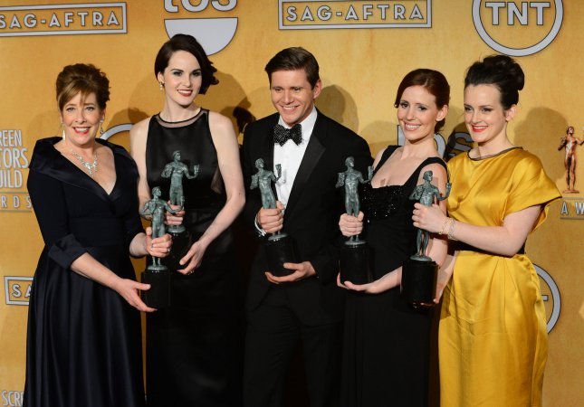 Actors Phyllis Logan, Michelle Dockery, Allen Leech, Amy Nuttall and Sophie McShera (L-R), winners of Outstanding Performance by an Ensemble in a Drama Series for Downton Abbey, appear backstage with their awards at the 19th annual SAG Awards held at the Shrine Auditorium in Los Angeles on January 27, 2013. UPI/Jim Ruymen