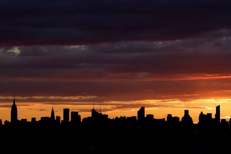 The sun sets behind the Manhattan skyline. UPI/John Angelillo