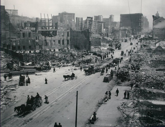 Pedestrians and horse-drawn wagons move along a section of Market Street in San Francisco following a devastating April 18, 1906, earthquake that killed about 3,000 people. National Archives/File/UPI