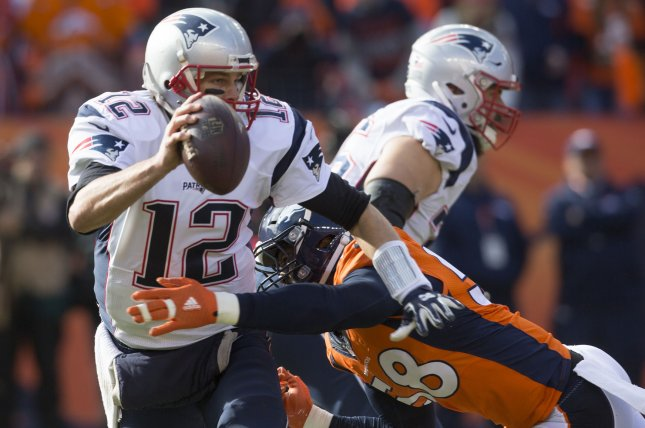 New England Patriots quarterback Tom Brady (12) avoids sack by Denver Broncos linebacker Von Miller during the AFC Championship game at Sport Authority Field at Mile High in Denver on January 24, 2016. Photo by Gary C. Caskey/UPI