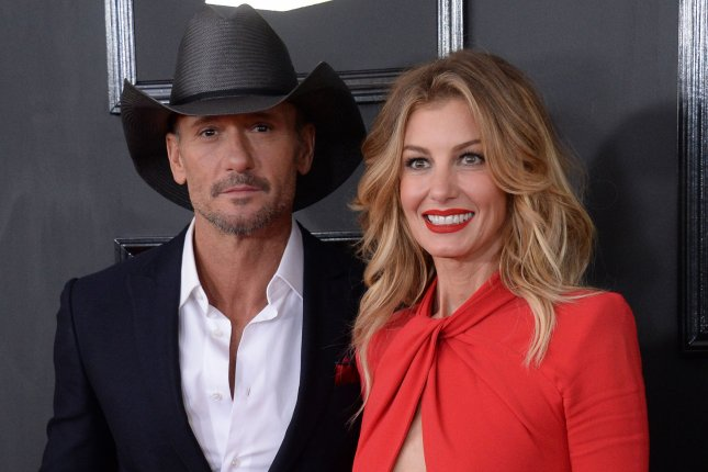 Singers Tim McGraw and Faith Hill arrive for the 59th annual Grammy Awards in Los Angeles on February 12. The couple are to perform together at Sunday's Academy of Country Music Awards ceremony. File Photo by Jim Ruymen/UPI