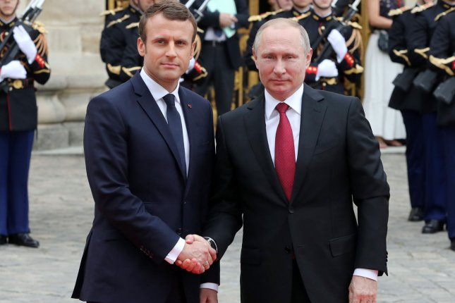 French President Emmanuel Macron (L) greets his Russian counterpart Vladimir Putin upon his arrival Monday at the Versailles Palace, near Paris. It was Putin's first official visit to France since Macron was elected to France's presidency earlier this month. Photo by Maya Vidon-White/UPI