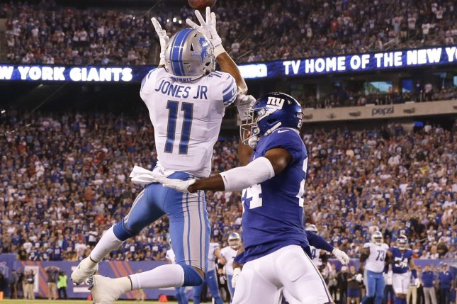 Detroit Lions wide receiver Marvin Jones Jr. catches a 27-yard touchdown pass over New York Giants cornerback Eli Apple in the first quarter in Week 2 of the NFL season on September 18 at MetLife Stadium in East Rutherford, N.J. Photo by John Angelillo/UPI