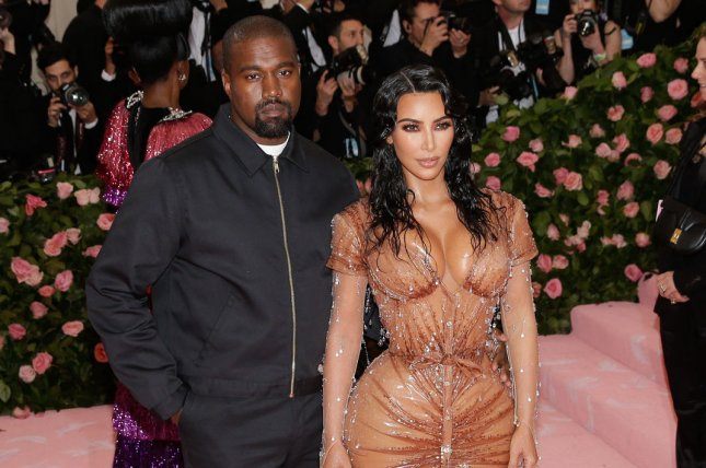 Kanye West (L) with his wife, Kim Kardashian. The rapper released a new album on Christmas Day. File Photo by John Angelillo/UPI