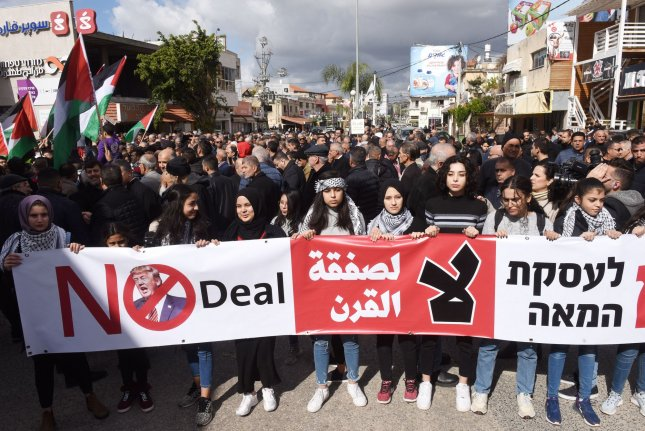 Israeli Arabs carry a banner in a protest march against President Donald Trump's Middle East peace plan in Baqa al-Gharbiya, Israel, on Saturday. Photo by Debbie Hill/UPI