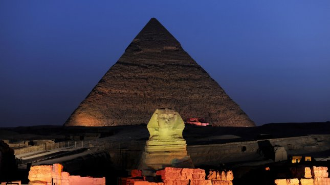 On the Giza Plateau in Giza, Egypt, the Sphinx and Great Pyramids are illuminated during the nightly performance of the Sound and Light Show on June 23, 2010. UPI/Joe Marino
