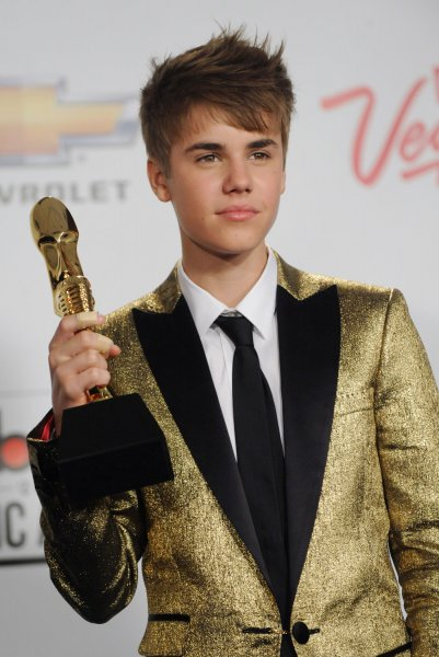 Singer Justin Bieber appears backstage after garnering Top New Artist award during the 2011 Billboard Music Awards at the MGM Hotel in Las Vegas, Nevada on May 22, 2011. UPI/Jim Ruymen