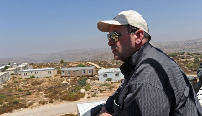 Former U.S. Republican Presidential candidate Mike Huckabee looks at house trailers used to expand the Israeli settlement Beit El in the West Bank, Aug. 18, 2009. UPI Photo/Debbie Hill