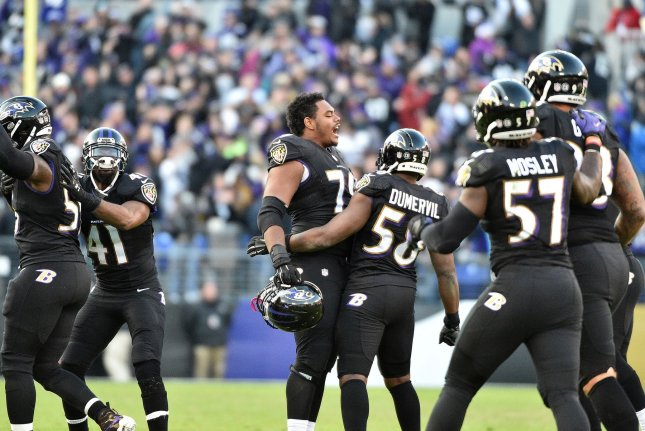 Baltimore Ravens' defenders Ronnie Stanley (79) and Elvis Dumervil (58) celebrate a Cincinnati Bengals turnover late in the second half of their NFL game at M&T Bank Stadium in Baltimore, Maryland, November 27, 2016. Baltimore won 19-14. Photo by David Tulis/UPI