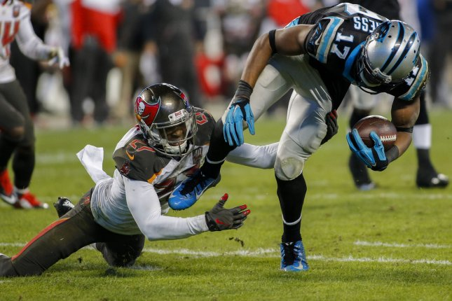 Carolina Panthers wide receiver Devin Funchess, right, breaks free from former Tampa Bay Buccaneers cornerback Johnthan Banks to score a touchdown in the second half of an NFL football game in 2016 at Bank of America Stadium in Charlotte, N.C. File photo by Nell Redmond/UPI