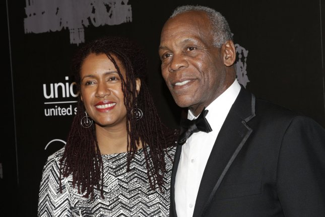 Danny Glover (R) pictured here with Eliane Cavalleiro (L) will receive the Lifetime Achievement Award at the upcoming NAACP Image Awards. File Photo by John Angelillo/UPI