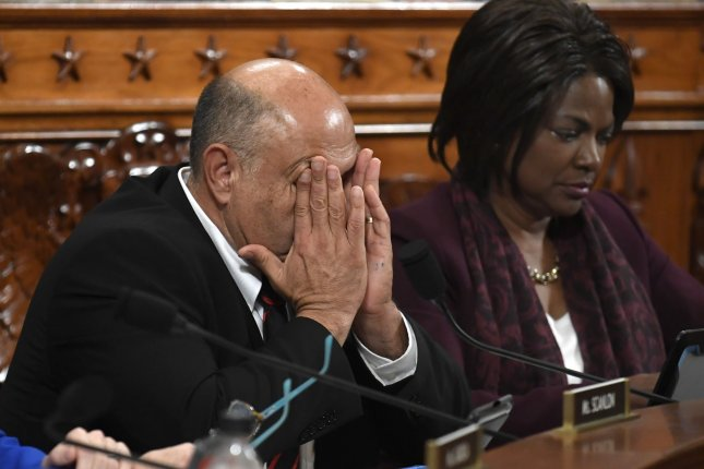 Rep. Lou Correa, D-Calif., shown here with Rep. Val Demings, R-Fla., in December 2019, announced Saturday that he has contracted COVID-19. Photo by Mike Theiler/UPI