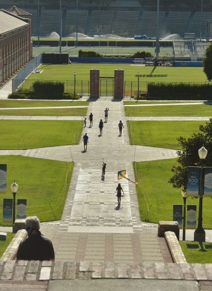Students walk in a quad near Royce Hall on the UCLA campus in Los Angeles on May 13, 2020. On Friday, the school's former men's soccer coach was sentenced to eight months in prison for accepting $200,000 in bribes for a colleges admissions scam. File Photo by Jim Ruymen/UPI
