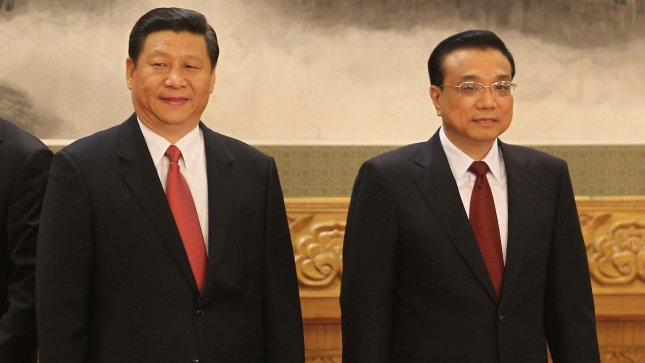 China's newly elected President Xi Jinping (L) stands next to Premier Li Keqiang during a meeting with both foreign and domestic press at the end of the 18th Communist Party Congress (CPC) in Beijing on November 15, 2012. Xi Jinping has been confirmed as the man to lead China for the next decade, and says the ruling Communist Party faces severe challenges. UPI/Stephen Shaver