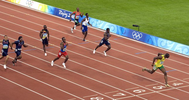 Jamaican Usain Bolt sprints (R) to the finish line taking the gold medal and setting a new world record of 19.30 seconds in the Men's 200m final on August 20, 2008. Bolt has become the second man in history to sweep the 100m and 200m at the same Olympic Games. Netherlands Antilles' Churandy Martina finished second in 19.82 (lane 7), USA's Shawn Crawford finished third in 19.96 (lane 4), USA's Walter Dix finished fourth in 19.98 (lane 8), Zimbabwe's Brian Dzingai finished fifth in 20.22 (lane 6), Britain's Christian Malcolm finished sixth in 20.40 (lane 3), Saint Kitss and Nevis' Kim Collins finished seventh in 20.59 (lane 2) and USA's Wallace Spearmon was disqualified (lane 9). (UPI Photo/Stephen Shaver)