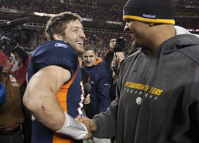 Denver Broncos quarterback Tim Tebow shakes hands with a Pittsburgh Steelers player after an overtime win in the AFC Wild Card round at Sports Authority Field at Mile High on January 8, 2012 in Denver. The Broncos advance beating the Steelers 29-23 in overtime. UPI/Gary C. Caskey