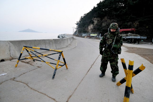 A South Korean marine stands guard a road on Yeonpyeong Island, South Korea, on December 22, 2010. North Korea fired rounds of artillery during what appeared to be a training exercise near the disputed maritime border with the South early Saturday. UPI/Keizo Mori