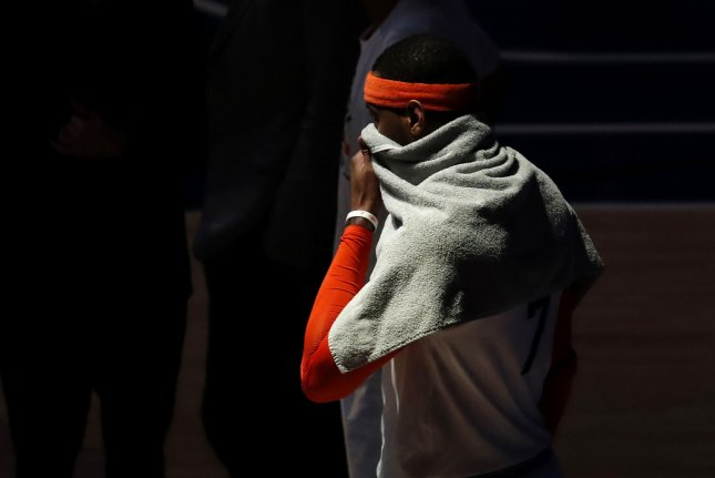 New York Knicks star Carmelo Anthony puts a towel to his face during a time out in the first half against the Charlotte Hornets on January 27 at Madison Square Garden in New York City. File Photo by John Angelillo/UPI