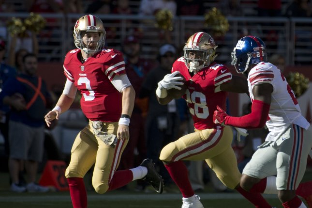 San Francisco 49ers RB Carlos Hyde (28) runs for 28 yards led by QB C.J. Beathard (3) in the first quarter against the New York Giants at Levi's Stadium in Santa Clara, California, California on November 12, 2017. The 49ers had their first win of the season 31-21. Photo by Terry Schmitt/UPI