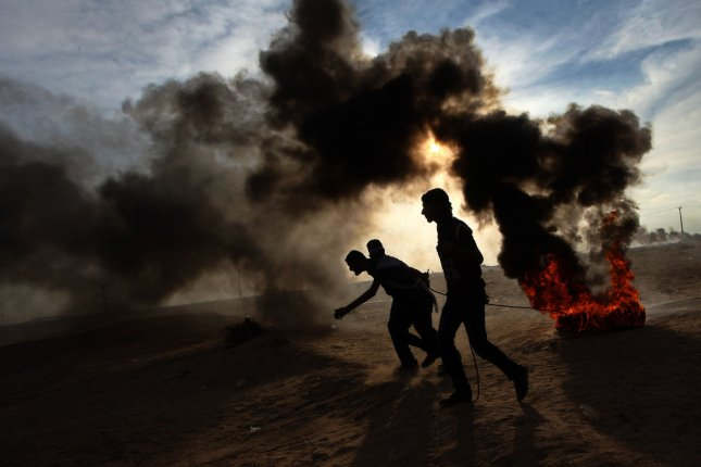 The Gaza Health Ministry said more than 208 Palestinians have been killed in protests at the Gaza-Israel border since weekly protests began March 30. File Photo by Ismael Mohamad/UPI