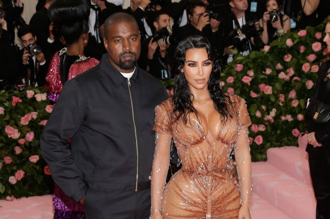 Kanye West (L) with his wife Kim Kardashian. West has posted on Twitter that his new album will be released on Friday. File Photo by John Angelillo/UPI