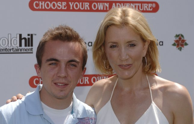 Actor Frankie Muniz (L) and actress Felicity Huffman arrive for the premiere of 'Choose Your Own Adventure: The Abominable Snowman' held in Culver City, California on July 22, 2006 . (UPI Photo/ Phil McCarten)