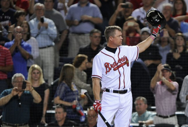 Retiring Atlanta Braves third baseman Chipper Jones salutes the crowd in the ninth inning of the National League wild-card baseball game with the St. Louis Cardinals at Turner Field in Atlanta, Oct. 5, 2012. UPI/David Tulis