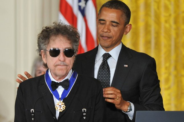 President Barack Obama awards the the Presidential Medal of Freedom to singer-songwriter Bob Dylan during a May 29, 2012, ceremony in the East Room at the White House. Dylan's archives -- including photographs, videos and memorabilia -- has been acquired by the University of Tulsa and the George Kaiser Family Foundation. File Photo by Kevin Dietsch/UPI