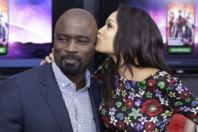 Mike Colter (L) and Rosario Dawson at the Daredevil Season 2 premiere on Thursday. The actor will reprise Luke Cage in a new Netflix series. Photo by John Angelillo/UPI