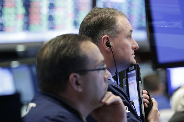 Traders work on the floor of the New York Stock Exchange on Wall Street in New York City. the Dow Jones Industrial Average posted its largest single-day loss since before the election amid mounting problems for President Donald Trump's agenda. File Photo by John Angelillo/UPI