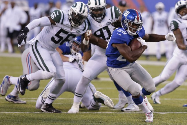 New York Giants running back Paul Perkins carries the football in the first quarter of a preseason game against the New York Jets on August 26, 2017 at MetLife Stadium in East Rutherford, New Jersey. Photo by John Angelillo/UPI