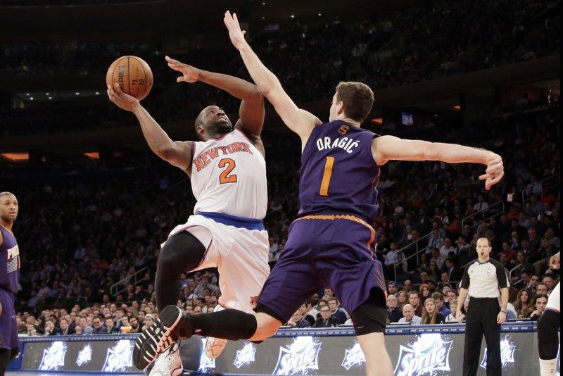 Phoenix Suns Goran Dragic defends New York Knicks Raymond Felton who drives to the basket in the second half at Madison Square Garden in New York City on January 13, 2014. (File/UPI/John Angelillo)