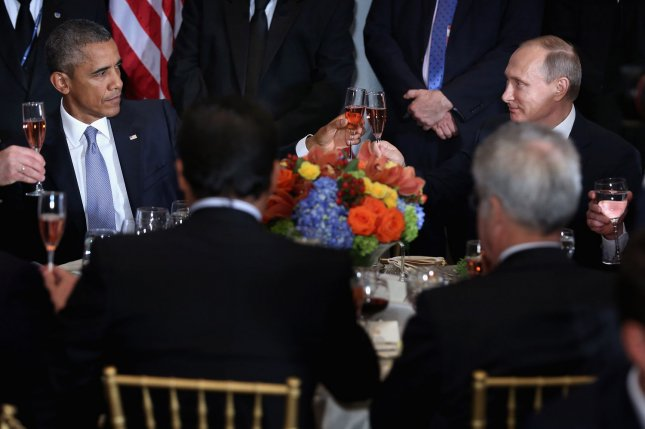 U.S. President Barack Obama, left, and Russian President Valdimir Putin toast Monday during a luncheon hosted by United Nations Secretary-General Ban Ki-moon during the 70th annual UN General Assembly at the UN headquarters in New York City. Obama held a bilateral meeting with Indian Prime Minister Narendra Modi and with have a face-to-face meeting with Russian President Vladimir Putin later in the day. Pool photo by Chip Somodevilla/UPI