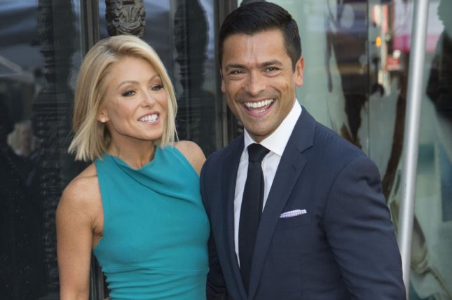 Kelly Ripa (L) and husband Mark Consuelos at Ripa's Hollywood Walk of Fame ceremony on October 12, 2015. File Photo by Phil McCarten/UPI