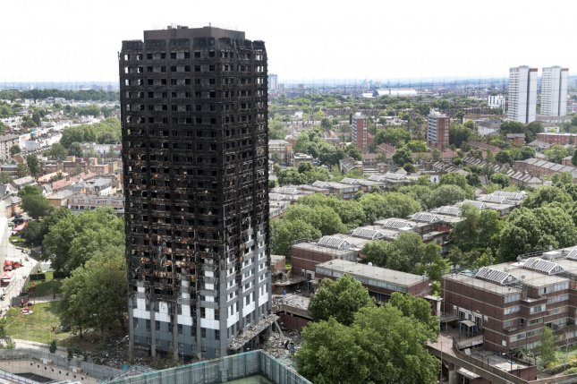 London's Grenfell Tower fire in which at least 79 people died led to the testing of cladding in at least 95 buildings, all which failed in their fire safety examinations. Britain's prime minister has called for a major national investigation to prevent further tragedies. Photo by Hugo Philpott/UPI