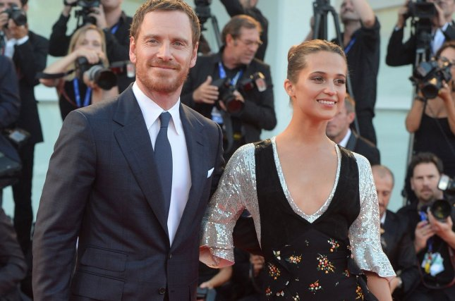 (L-R) Michael Fassbender and Alicia Vikander attend the premiere of The Light Between Oceans at the 73rd Venice Film Festival on September 1, 2016. The couple is reported to have gotten married. File Photo by Rune Hellestad/ UPI
