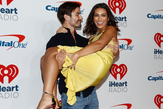 Ashley Iaconetti (R) and Jared Haibon attend the iHeartRadio Music Festival on Friday. Photo by James Atoa/UPI