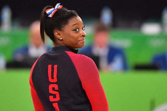 Team USA star Simone Biles has won 20 consecutive all-around gymnastics titles, including one at the 2016 Rio de Janeiro Olympics. File Photo by Kevin Dietsch/UPI