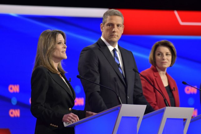Democratic presidential candidate Marianne Williamson (L) speaks at a primary debate in Detroit, Mich., on July 30, 2019. She attended the first two debates but failed to qualify for the next four after the party tightened participation requirements. File Photo by Edward M. PioRoda/CNN/UPI